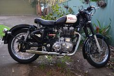 My 2010 Royal Enfield Bullet C5. After-market pipe, clubman bars, mirrors, indicators & brackets, tail light & numberplate mount, and headlight stone guard.