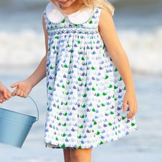 The Girls Nantucket Whale Dress beautiful style for girls features a whimsical whale print, custom smocking, and a classic collar with blue and green gingham trim. Whale Print, Girls Dresses, Summer Dresses, Team Gifts, Whale Watching, Nantucket, Smocking, Gingham, Boy Or Girl