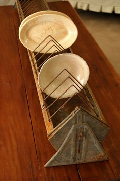 Old Chicken Feeder...repurposed into  farmhouse plate rack. I've got a bunch if these!