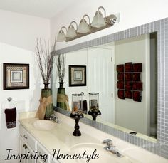 Easy, inexpensive way to add interest to builder grade bathroom mirror!