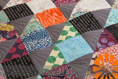 Piece N Quilt: Half Square Triangle Quilt - Deciding How-To Quilt a Quilt: Creating secondary patterns is such a fun way to add an element of interest to a quilt.