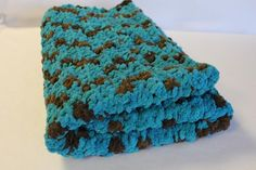 "Crochet Chenille Baby Blanket, Stroller Blanket, Car Seat Blanket, Photo Prop, Brown-Teal Ready to Ship. Crochet chenille baby blanket. Super soft and snuggly. Also great for car seat, stroller or a photo prop. Brown and Teal. Measures 29"" x 30"" Easy care. Machine wash warm, gently cycle. Lay flat to dry or tumble dry low. 100% Polyester."
