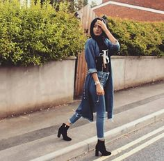 high-waisted skinny jeans + black shirt + long denim raw hem jacket + ankle boots + scarf/hijab