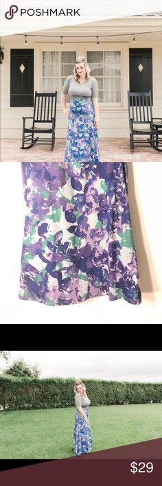Purple/ Grey Maxi Skirt Purple floral with a grey background maxi skirt. It's a Lularoe brand & very comfortable and soft. Stretchy yoga band waste. I wore it once for a few minutes during this photo shoot seen in the photos. LuLaRoe Skirts Maxi