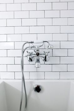 Bathroom renovation example. From bad 80's to bright and modern. Bathroom transformation to white contemporary. Spa bathroom renovation. Spa bathroom ideas. Subway tile bathroom wall. Tile on front of bathtub. Marble look tile floors. Quartz countertop in bathroom. #bathroombathtubwhite