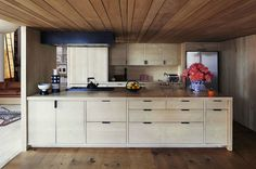 Love the simplicity of the flat front cabinetry (by Sim Achenbach). Cabinets - Share Design Van Lamsweerde and Matadin Manhattan Loft Plywood Kitchen, Loft Kitchen, Wooden Kitchen, Kitchen Interior, Kitchen Dining, Kitchen Island, Manhattan Loft, Manhattan Apartment, York Apartment