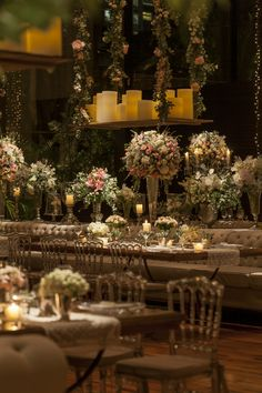 Light color wedding, decorated with strings light, acrylic chairs, and flowers arrangements