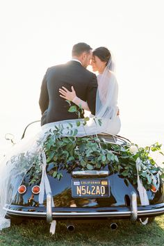 """From the editorial """"When East Coast Style Meets the West at an Elegant Seaside Bluff Affair in Santa Barbara."""" We are obsessing over this vintage car adorned with silk and greenery!  LBB Photography: @nataliebrayphoto  #vintagecar #vintageweddingcar #weddingtransportation #santabarbarawedding Wedding Photography Inspiration, Wedding Inspiration, Photography Ideas, Industrial Wedding, Rustic Wedding, Vintage Inspired Wedding Dresses, Vintage Weddings, East Coast Style, Wedding Transportation"""