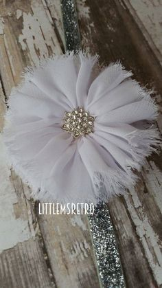 Vintage New Years White Frayed Flower with Starburst Embellishment on Silver Glittery Headband - pinned by pin4etsy.com
