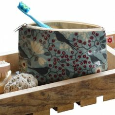 Items similar to Rowan Bird Oilcloth Wash Bag by Susie Faulks/ Make Up Purse/ Oilcloth Bags / Waterproof Lining / Made in England on Etsy Wash Bags, Rowan, Textile Design, Oilcloth, Bag Accessories, Diaper Bag, Tote Bag, How To Make, Britain