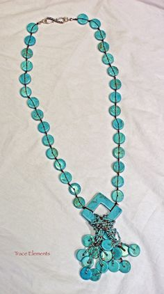 """No wardrobe should ever be without Turquoise. This hand knotted necklace is made with Turquoise rondelles, seed beads, and a turquoise squaredelle pendant. The necklace is 27-1/2"""" long with a 3"""" handcrafted tassel. The clasp is a sterling silver s-clasp.  $120"""