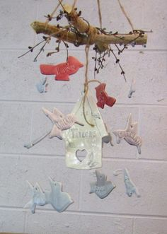 Hey, I found this really awesome Etsy listing at https://www.etsy.com/listing/474179882/birdhouse-family-tree-wind-chime