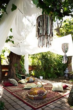 Persian rug and white curtains in the garden.  Think space.  Tea time.  Floor seating.
