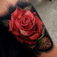 Red rose tattoo  This is insanely beautiful. A bit dark around the edges but so much detail!