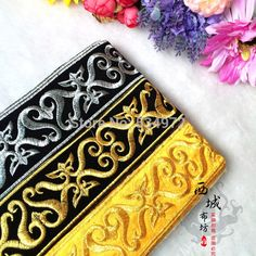 5 cm US $1.48 x 6 yards # Youu1984 [US $1.72 x 12 yards # Joyworld http://www.aliexpress.com/store/product/Sequin-patches-sequin-hair-accessory-paillette-flower-patches-multicolor-beads-flower-applique-Costume-accessories-60/320437_32252171987.html]