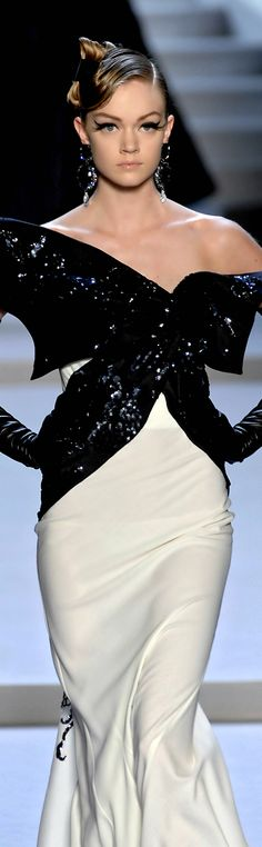 Christian Dior - Fantastic style, and a brilliant statement of classic black & white. http://www.theimagearchitect.com