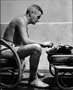 William Faulkner works on a screenplay on a balcony, Hollywood in the early 1940s.