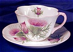 Shelley Dainty Thistle cup & saucer.The famous Dainty shape relief molded with six deep flutes; saucer is scalloped. Porcelain. England. c. 1940-1966.