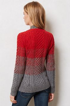 never thought to color block yarns on a traditional cable knit sweater. I like the effect!
