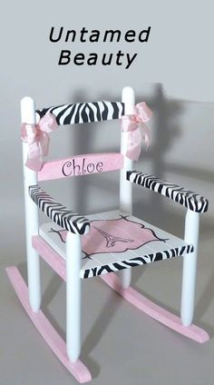 Hand painted and personalized child's Zebra Rocking Chair adds an exotic touch to the nursery. Available at Neat Stuff Gifts.