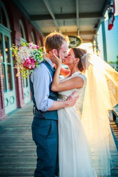 Bride and Groom passionately kiissing in Old Sacramento after their wedding