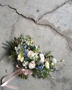 A perfect bridal bouquet for our Friyay wedding today! Including patience garden roses, blue and white delphinium, white lisianthus, wheat and cedar. Congratulations beautiful bride! Designed by @heather_page!