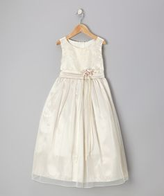 Much like fairy dust and shooting stars, this dress is the stuff dreams are made of. Fitted with a frilly floral flourish, ribbon accents and a sweetly pleated skirt, it's the perfect look for graceful little ones on the big day.100% polyesterHand wash; hang dryMade in the USA