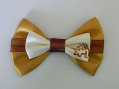 The Lion King Inspired Hair Bow by MadHatterBows on Etsy https://www.etsy.com/listing/197553455/the-lion-king-inspired-hair-bow