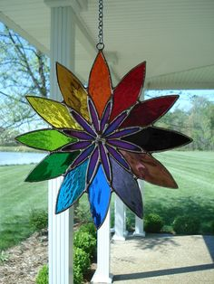 Artful Home Decorating Ideas Using Stained Glass Panels. In past centuries, stained glass panels were used to create pictorial stories in cathedral windows Stained Glass Ornaments, Stained Glass Suncatchers, Stained Glass Flowers, Stained Glass Designs, Stained Glass Panels, Stained Glass Projects, Stained Glass Patterns, Stained Glass Art, Mosaic Glass