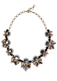 A beautiful necklace that will stand out in any outfit. Earthy greys, browns and blacks give this necklace a refined, regal look. This can be worn with casual or formal wear, but best with a plain coloured top to let the necklace stand out.