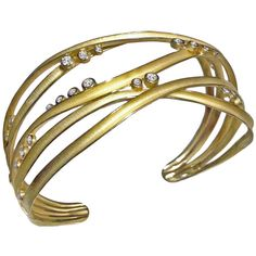 Diamond Gold Ribbon Cuff | From a unique collection of vintage cuff bracelets at https://www.1stdibs.com/jewelry/bracelets/cuff-bracelets/