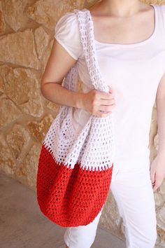 Light and durable, with a mesh pattern to let out the sand, this hot red crochet bag will more than suit your needs! It's bright, fun, and practical all at once. And it has LOADS of space for all your swimming accessories! Hit the beach with confidence. Your crochet beach bag will be the talk of the town!  $27.00