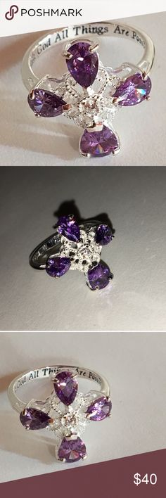 """Sterling Silver Amethyst Faith Ring Gorgeous sterling silver """"With Faith"""" ring. Four beautiful purple stones surrounding a crystal jewel center. Elegant and high quality with an inscription saying """"With God all things are possible"""" on the inside band. Comes New in Box Avon Jewelry Rings"""