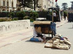 Man sleeping under a cart in Essaouira