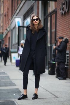 black coat, black top, black cropped jeans, black loafers, work