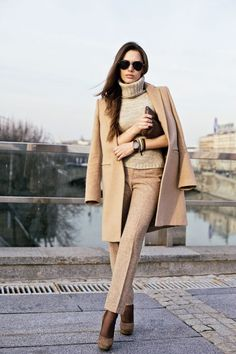 A smart casual combination of a khaki coat and camel dress pants can maintain its relevance in many different circumstances. Complement this look with dark brown suede pumps.   Shop this look on Lookastic: https://lookastic.com/women/looks/coat-turtleneck-dress-pants/16931   — Tan Turtleneck  — Camel Coat  — Dark Brown Leather Clutch  — Khaki Dress Pants  — Dark Brown Suede Pumps