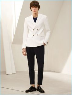 Elias de Poot models a white double-breasted blazer, sweater, cropped trousers and antik leather bluchers from Zara Man.
