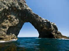 On Anacapa Island in Channel Islands National Park, waves have shaped towering sea cliffs, sea caves, and natural bridges, such as 40-foot-high Arch Rock. [Photo by James Forte]