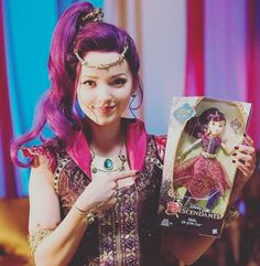 Awe! Look at @dovecameron with her #GenieChic doll! You can get yours here: http://www.target.com/p/disney-descendants-genie-chic-mal-of-isle-of-the-lost/-/A-50282061?lnk=rec|pdp|related_prods_vv|pdpv1  and don't forget to watch Dove's #GenieInABottle video here: https://www.youtube.com/watch?v=QFlLybox4To