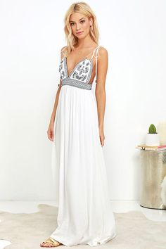 Make that sunny afternoon even more magical with the Days of Sunlight Ivory Embroidered Maxi Dress! Gauzy woven rayon swings from tying spaghetti straps (with beads) to a triangle bodice with navy blue embroidery. Smocked waist tops the maxi skirt.