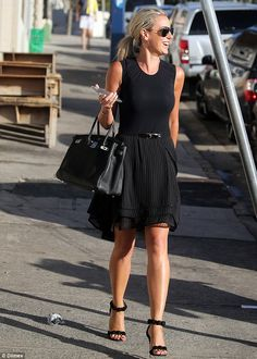 Wouldn't want to spill anything on that! Controversial socialite Roxy Jacenko emerged in Bondi for a casual dinner wearing around $84K worth of designer clothing on Monday