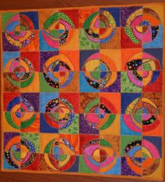 Layered circles - raw edge applique with cut-away sections.