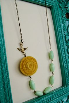 Mustard and Mint Rosette Beaded Necklace with Antique Bronze Bird. $22.00, via Etsy.