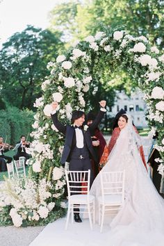 """From the editorial """"This Underrated Destination Wedding Locale in Europe Is a Music Lover's Dream."""" How sweet is this snap of the bride and groom at their beautiful outdoor ceremony? All details on SMP! Photography: @stefaniekapraphoto #brideandgroom #weddingceremony #ceremonyarch #floralarch"""