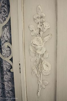 .i wonder if you could dip an artificial rose in heavy starch, let dry, tack to wood and then paint?  must try sometime!