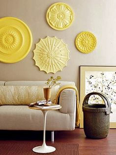 Paint ceiling medallions & use as wall decor.