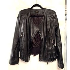 Cecico Black faux leather jacket with ruffle trim Like new. Worn once. Size women's large black leather faux jacket with ruffle trim. Padded shoulders. Cecico Jackets & Coats Blazers