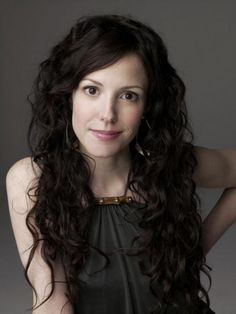 Mary Louise Parker - Long curly hair  - My hair does this and yet I feel like it still looks better on her.