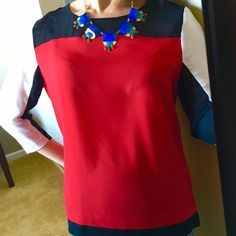 Colorblock DKNYC top Red, black and white color block top. Lost the size tag, but about a size S/M. Black panels are slightly sheer. Very versatile style and color - my favorite was wearing it with a black & white houndstooth skirt. Excellent condition! Necklace pictured sold in another listing. DKNYC Tops