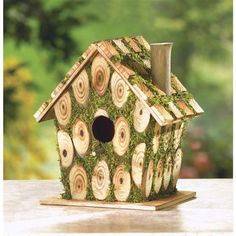 Moss-Edged Bird House - This is knot your ordinary birdhouse! Charmingly constructed of bits of knotty wood and richly trimmed with bright green faux-moss, this crafty little cottage brings whimsical homespun fun to your garden. Bird House Feeder, Bird Feeders, Little Cottages, Birdhouse Designs, Bird House Kits, Bird Aviary, Plus 4, Wood Rounds, Backyard Birds